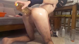 Twink gapes his oiled hole
